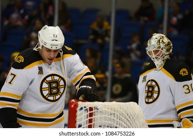 UNIONDALE, NEW YORK, UNITED STATES – Nov. 2, 2013: NHL Hockey: Milan Lucic and goaltender Chad Johnson of the Boston Bruins during warm-ups. Bruins vs. New York Islanders at Nassau Coliseum.