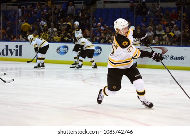 UNIONDALE, NEW YORK, UNITED STATES – Nov. 2, 2013: NHL Hockey: Dougie Hamilton with his Boston Bruins teammates during warm-ups prior to a game against New York Islanders at Nassau Coliseum.