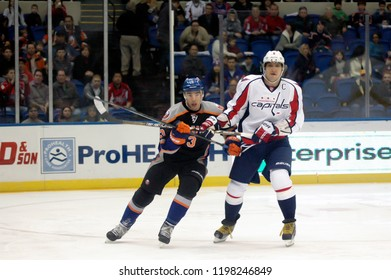 UNIONDALE, NEW YORK, UNITED STATES – March 9, 2013: NHL Hockey: Alex Ovechkin of the Washington Capitals, right, and Travis Hamonic of the New York Islanders during a game at Nassau Coliseum.
