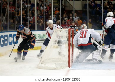 UNIONDALE, NEW YORK, UNITED STATES – March 9, 2013: NHL Hockey: Game action between the Washington Capitals and New York Islanders at Nassau Coliseum. Frans Nielsen #51. John Carlson #74.