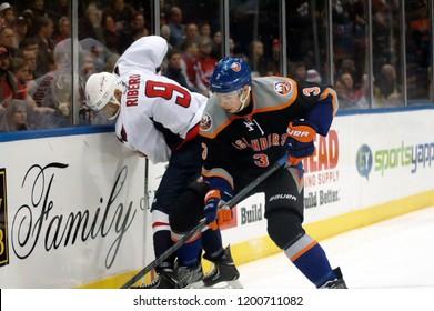 UNIONDALE, NEW YORK, UNITED STATES – March 9, 2013: NHL Hockey: Game action between the Washington Capitals and New York Islanders at Nassau Coliseum. Mike Ribeiro #9. Travis Hamonic #3.