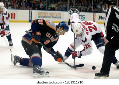 UNIONDALE, NEW YORK, UNITED STATES – March 9, 2013: NHL Hockey: Matt Hendricks of the Washington Capitals, and John Tavares of the New York Islanders face-off during a game at Nassau Coliseum.