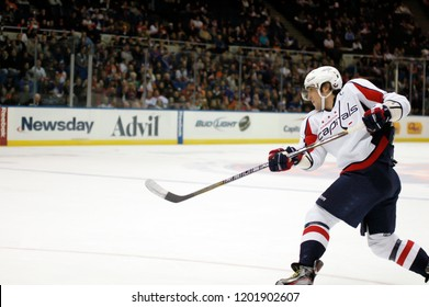 UNIONDALE, NEW YORK, UNITED STATES – March 9, 2013: NHL Hockey: Alex Ovechkin, of the Washington Capitals, shoots during a game between the Capitals and New York Islanders at Nassau Coliseum.