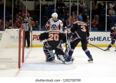 UNIONDALE, NEW YORK, UNITED STATES – March 9, 2013: NHL Hockey: Game action between the Washington Capitals and New York Islanders at Nassau Coliseum. Travis Hamonic. Evgeni Nabokov. Jason Chimera.