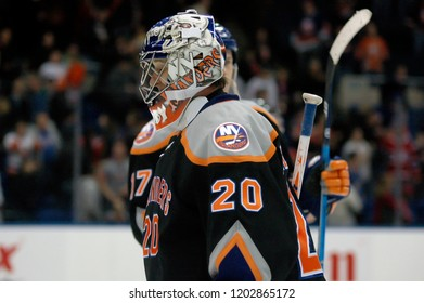 UNIONDALE, NEW YORK, UNITED STATES – March 9, 2013: NHL Hockey: Goalie Evgeni Nabokov, of the New York Islanders, during a game between the Islanders and Washington Capitals at Nassau Coliseum.