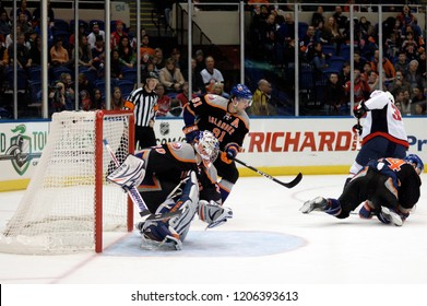 UNIONDALE, NEW YORK, UNITED STATES – March 9, 2013: NHL Hockey: Goalie Evgeni Nabokov and John Tavares of the New York Islanders during a game against the Washington Capitals at Nassau Coliseum.