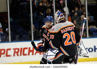 UNIONDALE, NEW YORK, UNITED STATES – March 9, 2013: NHL Hockey: Goalie Evgeni Nabokov and Mark Streit of the New York Islanders during a game against the Washington Capitals at Nassau Coliseum.