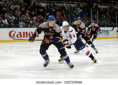 UNIONDALE, NEW YORK, UNITED STATES – March 9, 2013: NHL Hockey: Game action between the Washington Capitals and New York Islanders at Nassau Coliseum. Travis Hamonic #3. Alex Ovechkin #8.
