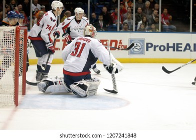 UNIONDALE, NEW YORK, UNITED STATES – March 9, 2013: NHL Hockey: Game action between the Washington Capitals and New York Islanders at Nassau Coliseum. Philipp Grubauer #31. John Carlson #74.