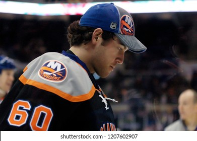 UNIONDALE, NEW YORK, UNITED STATES – March 9, 2013: NHL Hockey: Goalie Kevin Poulin of the New York Islanders during a break in the game against the Washington Capitals at Nassau Coliseum.