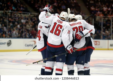 UNIONDALE, NEW YORK, UNITED STATES – March 9, 2013: NHL Hockey: Washington Capitals players celebrate scoring a goal against the New York Islanders at Nassau Coliseum. Eric Fehr #16. Troy Brouwer #20.