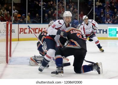 UNIONDALE, NEW YORK, UNITED STATES – March 9, 2013: NHL Hockey: Game action between the Washington Capitals and New York Islanders at Nassau Coliseum. Travis Hamonic #3. Matt Hendricks #26.