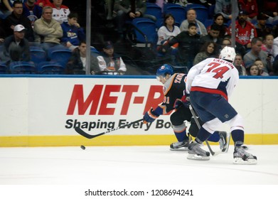 UNIONDALE, NEW YORK, UNITED STATES – March 9, 2013: NHL Hockey: John Carlson of the Washington Capitals, and John Tavares of the New York Islanders during a game at Nassau Coliseum.