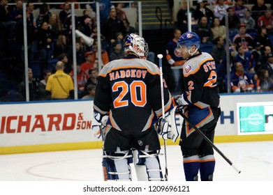 UNIONDALE, NEW YORK, UNITED STATES – March 9, 2013: NHL Hockey: Mark Streit and goalie Evgeni Nabokov of the New York Islanders during a game against the Washington Capitals at Nassau Coliseum.