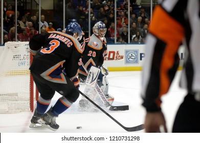UNIONDALE, NEW YORK, UNITED STATES – March 9, 2013: NHL Hockey: Game action between the Washington Capitals and New York Islanders at Nassau Coliseum. Travis Hamonic  3. Evgeni Nabokov  20.