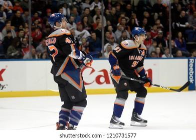 UNIONDALE, NEW YORK, UNITED STATES – March 9, 2013: NHL Hockey: Game action between the Washington Capitals and New York Islanders at Nassau Coliseum. Andrew MacDonald  47. John Tavares  91.