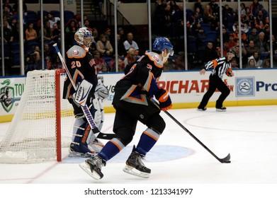 UNIONDALE, NEW YORK, UNITED STATES – March 9, 2013: NHL Hockey: Game action between the Washington Capitals and New York Islanders at Nassau Coliseum. Travis Hamonic #3. Evgeni Nabokov #20.