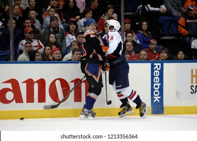 UNIONDALE, NEW YORK, UNITED STATES – March 9, 2013: NHL Hockey: Alex Ovechkin of the Washington Capitals, and David Ullstrom of the New York Islanders during a game at Nassau Coliseum.