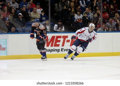 UNIONDALE, NEW YORK, UNITED STATES – March 9, 2013: NHL Hockey: John Carlson of the Washington Capitals, and Lubomir Visnovsky of the New York Islanders during a game at Nassau Coliseum.