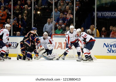 UNIONDALE, NEW YORK, UNITED STATES – March 9, 2013: NHL Hockey: Game action between the Washington Capitals and New York Islanders at Nassau Coliseum. Jay Beagle #83. Goalie Philipp Grubauer #31.