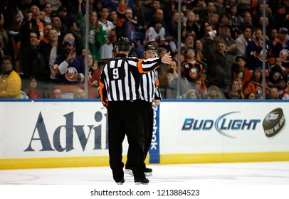 UNIONDALE, NEW YORK, UNITED STATES – March 9, 2013: NHL Hockey: Referee Dan O'Rourke signals a good goal for the New York Islanders against the Washington Capitals at Nassau Coliseum.