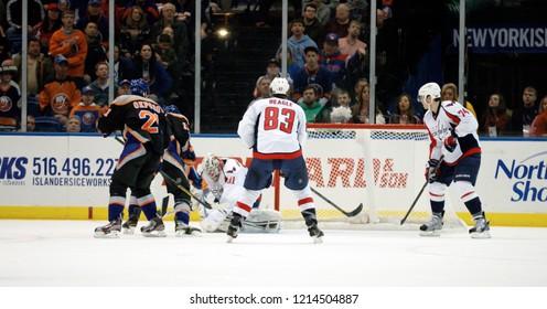 UNIONDALE, NEW YORK, UNITED STATES – March 9, 2013: NHL Hockey: Game between the Washington Capitals and New York Islanders at Nassau Coliseum. Jay Beagle #83. John Carlson #74. Philipp Grubauer #3.