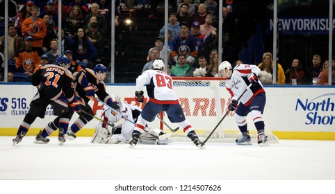 UNIONDALE, NEW YORK, UNITED STATES – March 9, 2013: NHL Hockey: Game between the Washington Capitals and New York Islanders at Nassau Coliseum. Jay Beagle #83. John Carlson #74. Philipp Grubauer #31.