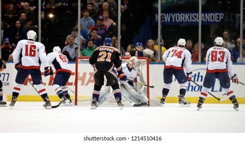 UNIONDALE, NEW YORK, UNITED STATES – March 9, 2013: NHL Hockey: Game action between Washington Capitals and New York Islanders at Nassau Coliseum. Jay Beagle #83. John Carlson #74. Kyle Okposo #21.