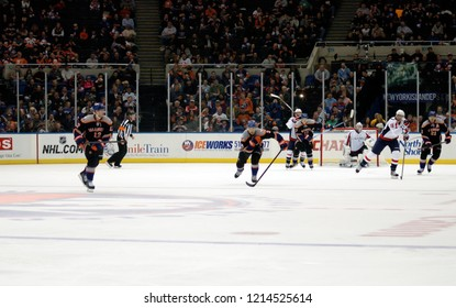 UNIONDALE, NEW YORK, UNITED STATES – March 9, 2013: NHL Hockey: Game action between Washington Capitals and New York Islanders at Nassau Coliseum. Josh Bailey #12. Travis Hamonic #3. Eric Fehr #16.