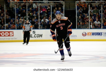UNIONDALE, NEW YORK, UNITED STATES – March 9, 2013: NHL Hockey: Travis Hamonic of the New York Islanders during a game between the Islanders and Washington Capitals at Nassau Coliseum.