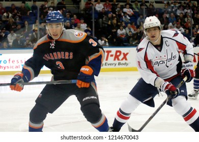 UNIONDALE, NEW YORK, UNITED STATES – March 9, 2013: NHL Hockey: Alex Ovechkin of the Washington Capitals, and Travis Hamonic of the New York Islanders during a game at Nassau Coliseum.