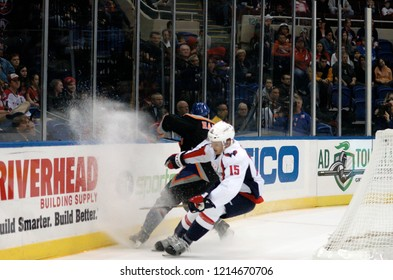 UNIONDALE, NEW YORK, UNITED STATES – March 9, 2013: NHL Hockey: Joey Crabb of the Washington Capitals, and Travis Hamonic of the New York Islanders during a game at Nassau Coliseum.