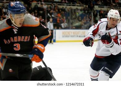 UNIONDALE, NEW YORK, UNITED STATES – March 9, 2013: NHL Hockey: Matt Hendricks of the Washington Capitals, and Travis Hamonic of the New York Islanders during a game at Nassau Coliseum.