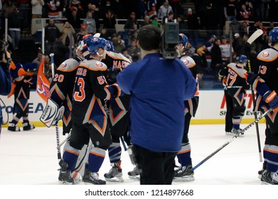 UNIONDALE, NEW YORK, UNITED STATES – March 9, 2013: NHL Hockey: The New York Islanders celebrate defeating the Washington Capitals at Nassau Veterans Memorial Coliseum.