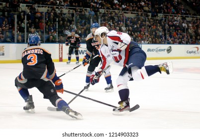 UNIONDALE, NEW YORK, UNITED STATES – March 9, 2013: NHL Hockey: Alex Ovechkin of the Washington Capitals shoots the puck against the New York Islanders at Nassau Coliseum.