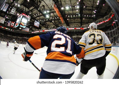 UNIONDALE, NEW YORK, UNITED STATES – Nov. 2, 2013: NHL Hockey: Game action between the Boston Bruins and New York Islanders at Nassau Coliseum. Zdeno Chara #33. Kyle Okposo #21.