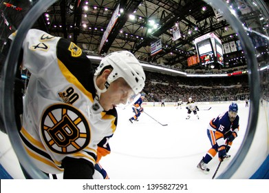 UNIONDALE, NEW YORK, UNITED STATES – Nov. 2, 2013: NHL Hockey: Game action between the Boston Bruins and New York Islanders at Nassau Coliseum. Carl Soderberg #34.
