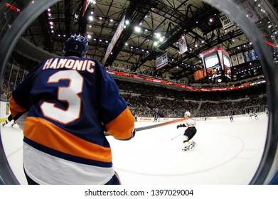 UNIONDALE, NEW YORK, UNITED STATES – Nov. 2, 2013: NHL Hockey: Game action between the Boston Bruins and New York Islanders at Nassau Coliseum. Travis Hamonic