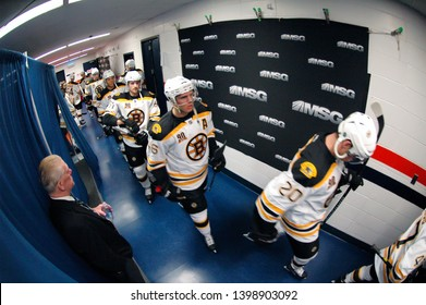 UNIONDALE, NEW YORK, UNITED STATES – Nov. 2, 2013: NHL Hockey: Boston Bruins players head out of the locker-room and onto the ice during a game against the New York Islanders at Nassau Coliseum.