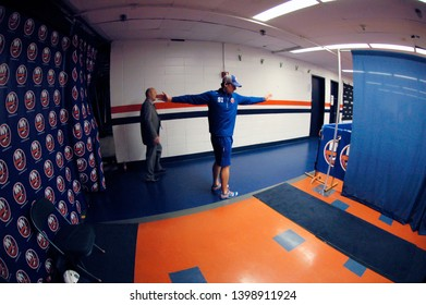 UNIONDALE, NEW YORK, UNITED STATES – Nov. 2, 2013: NHL Hockey: John Tavares, of the New York Islanders, stretches during his pregame routine prior to a game against the Bruins at Nassau Coliseum.
