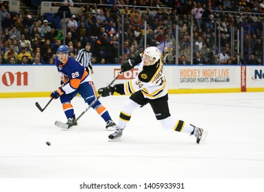 UNIONDALE, NEW YORK, UNITED STATES – Nov. 2, 2013: NHL Hockey: Boston Bruins forward Carl Soderberg shoots the puck during a game against the New York Islanders at Nassau Veterans Memorial Coliseum.