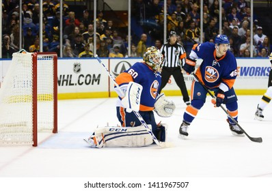 UNIONDALE, NEW YORK, UNITED STATES – Nov. 2, 2013: NHL Hockey: New York Islanders Goalie Kevin Poulin and defenseman Matt Donovan protect the net against the Boston Bruins at Nassau Coliseum.