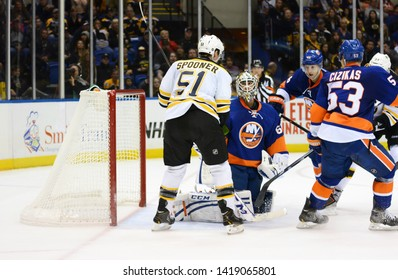 UNIONDALE, NEW YORK, UNITED STATES – Nov. 2, 2013: NHL Hockey: Game action between the Boston Bruins and New York Islanders at Nassau Coliseum. Ryan Spooner. Goalie Kevin Poulin. Casey Cizikas.