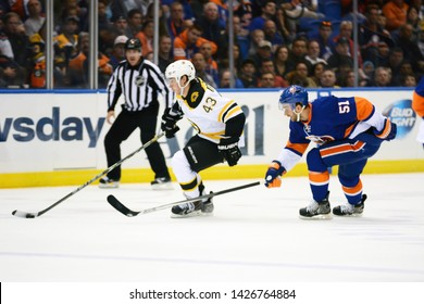 UNIONDALE, NEW YORK, UNITED STATES – Nov. 2, 2013: NHL Hockey: Game action between the Boston Bruins and New York Islanders at Nassau Coliseum. Matt Bartkowski #43. Frans Nielsen #51.