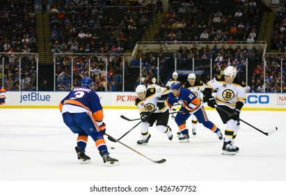 UNIONDALE, NEW YORK, UNITED STATES – Nov. 2, 2013: NHL Hockey: Game action between the Boston Bruins and New York Islanders at Nassau Coliseum. Travis Hamonic #3. Jarome Iginla #12. Milan Lucic #17.