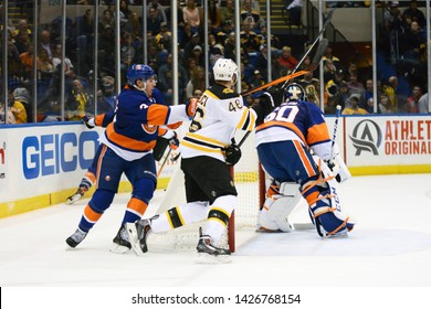 UNIONDALE, NEW YORK, UNITED STATES – Nov. 2, 2013: NHL Hockey: Game action between the Boston Bruins and New York Islanders at Nassau Coliseum. Travis Hamonic #3. David Krejci #46. Kevin Poulin #60.