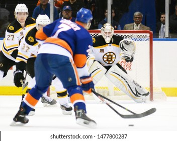 UNIONDALE, NEW YORK, UNITED STATES – Nov. 2, 2013: NHL Hockey: New York Islanders defenseman Matt Carkner winds up and shoots on Boston Bruins goalie Chad Johnson at Nassau Coliseum.