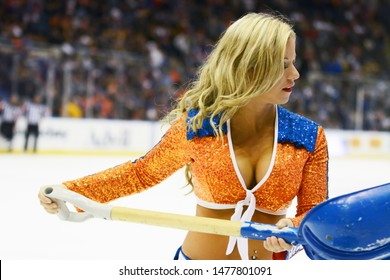 UNIONDALE, NEW YORK, UNITED STATES – Nov. 2, 2013: NHL Hockey: A New York Islanders Ice Girl at Nassau Veterans Memorial Coliseum during a break in the game between the Islanders and Boston Bruins.