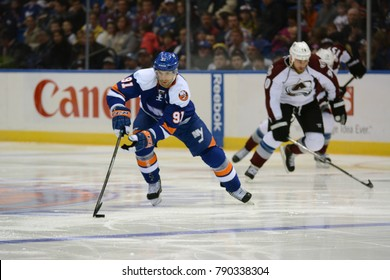 UNIONDALE, NEW YORK, UNITED STATES – FEB 8, 2014: NHL Hockey: John Tavares, of the New York Islanders during a game against the Colorado Avalanche at Nassau Veterans Memorial Coliseum.