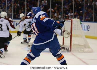 UNIONDALE, NEW YORK, UNITED STATES – FEB 8, 2014: NHL Hockey: John Tavares, of the New York Islanders, shoots and scores against the Colorado Avalanche at Nassau Veterans Memorial Coliseum.